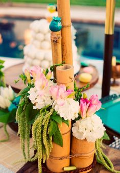 Pin for Later: Throw a Bikini Beach Bridal Bash Bamboo Centerpieces Photo by Sarah Layne Photography via 100 Layer Cake Bamboo Centerpieces, Vases Decor, Hawaiian Centerpieces, Centerpiece Ideas, Tiki Party, Luau Party, Beach Party, Hmong Wedding, Tiki Wedding