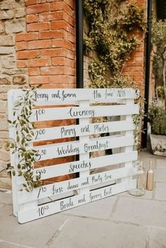DIY White Painted Palette Order of The Day Sign Wedding Decor Millbridge Court Surrey Wedding with DIY Decor Foliage Giant Balloons Nataly J Photography Pallet Wedding, Wedding Signage, Wedding Ceremony, Our Wedding, Free Wedding, Rustic Wedding Signs, Wedding Order Of Events, Pallet Ideas For Weddings, Wedding Ideas Using Pallets