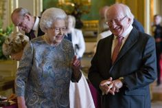 Queen Elizabeth II (L) shows Irish President Michael D Higgins (R) Irish related items from the Royal Collection, in the Green Drawing Room at Windsor Castle on April 8, 2014 in Windsor, England....