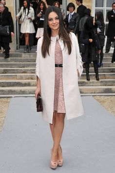 Mila Kunis reported to Dior's Fall 2012 show during Paris Fashion Week, as the current face of the brand's Miss Dior handbag line.