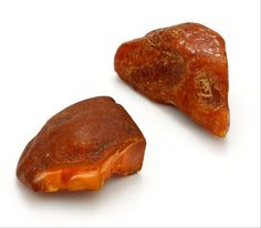 "Real Baltic amber has a rough surface when in its natural state. Traditional amber artisans do not modify the amber by melting, heating, or gluing smaller pieces together. Oftentimes, they will buff the amber to give it a smooth surface, but leave a small amount of the ""rind"" so that the wearer knows that it has not been changed. Courtesy of the International Amber Association."