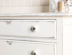 Chest of drawers painted in Chalk White. Shabby chic / distressed effect created with wire wool and fine grit sandpapers.