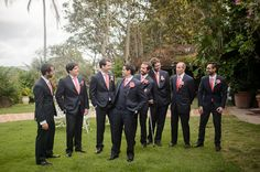 Groomsmen outfit idea - navy blue suits with white button-downs and bright pink neck ties {Camille Fontanez Photography}