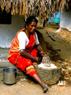 Who needs a Cuisinart or Osterizer when you have a Kal Ural and two strong hands? (Woman grinding rice Tamil Nadu, India)