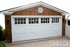 Coastal style garage doors may give your hope the classic look you have always wanted with the modern conveniences you need. Coastal Cottage, Garage Door Styles, Carriage House Doors, House Exterior, Garage Door House, Garage Door Design, Garage, Garage Door Types, Doors
