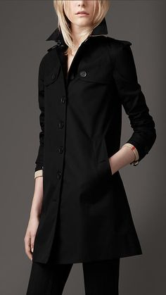 I have a black trench with a button in wool layer and a hood that I LOVE and is incredibly useful.
