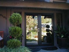 """Model: BP-450 Double Entry Door, Size: 7′ W x 8′ H Frame: Bronze Powder Coated Frame Glass: 1/4"""" Laminated Obscured: Bronze Location: Carmichael, CA"""