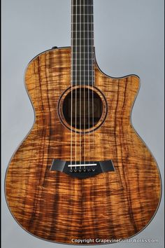 Yum Taylor acoustic Guitar.