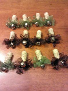 Wine Cork Ornaments - would make cute wine glass charms, minus the bell ... write name on cork!