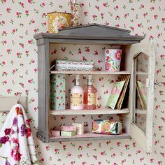 Small bathroom with floral wallpaper and vintage bathroom cabinet