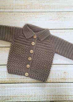 Crochet Baby Boy Sweater Pattern, Bentley Sweater - Crochet Dreamz This crochet baby boy sweater features a beautiful mix of 2 textured stitches and a sylish shawl collar. Boy Crochet Patterns, Crochet Baby Sweater Pattern, Crochet Baby Jacket, Crochet Baby Sweaters, Baby Sweater Patterns, Knitting Sweaters, Free Knitting, Crochet Designs, Baby Boy Knitting Patterns Free