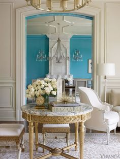 As you walk through, the rooms alternate between strong colors and pale neutrals - Veranda.com