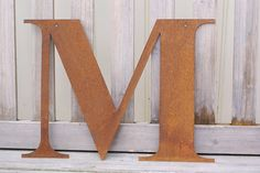 Rusted Metal Letter