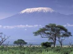Kilimanjaro mountain.... at the foothills are the TANZANITE Mines! :0)