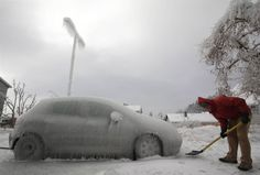 A man shovels next to an ice-covered car in Postojna, Slovenia, on Feb. A quarter of the households in Slovenia were left without electricity on Monday after a weekend of blizzards and very low temperatures wreaked havoc on power lines and roads. Ice Car, Science Images, Freezing Rain, Winter Songs, Ice Storm, Severe Storms, The Weather Channel, Train Tracks, Slovenia