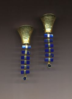 Earrings | Jeff and Susan Wise.  Lapis Lazuli Ladders hang from a hollow form sculpted in 18k gold.