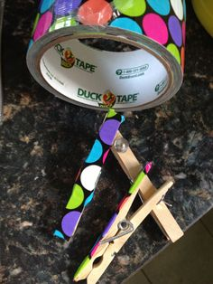 Duck tape covered clothes pins. Hot glued a thumb tack. Easy way to display  student work