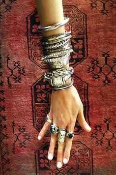 Boho chic stacked silver bracelets, bangles, & cuffs. Modern hippie layered jewelry. For MORE Bohemian fashion trends FOLLOW http://www.pinterest.com/happygolicky/the-best-boho-chic-fashion-bohemian-jewelry-gypsy-/