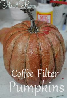 This little coffee filter pumpkin turned out great! I used natural coffee filters painted with watered down acrylics which was perfect for covering the pumpkin Faux Pumpkins, Halloween Pumpkins, Fall Halloween, Halloween Crafts, Halloween Decorations, Fabric Pumpkins, Burlap Pumpkins, Plastic Pumpkins, Halloween Nails