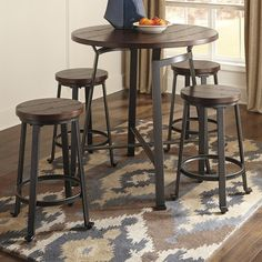 Challiman Round DRM Counter Table & 4 Stools by Signature Design by Ashley. Get your Challiman Round DRM Counter Table & 4 Stools at Furniture Warehouse, Holland MI furniture store. Patio Bar Set, Pub Table Sets, Dining Room Sets, Dining Room Table, Bar Tables, Kitchen Dining, Kitchen Tables, High Top Table Kitchen, High Top Tables