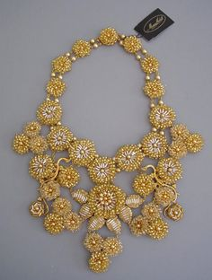Necklace   Miriam Haskell designed by Millie Petronzio in 2001.  Golden and silver tone glass bugle bead