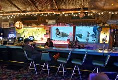 Mermaids await our arrival at the sip 39 n dip tiki bar in - Swimming pools in great falls montana ...