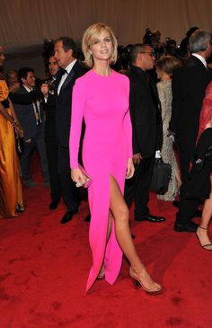 Brooklyn Decker Evening Dress - Brooklyn Decker embraced the neon trend at the 2011 Met Gala in a hot pink long-sleeved dress with a leg-revealing slit.