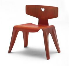Ray Eames and Charles Eames. Child's chair. 1944  Among the Eameses' earliest designs was a 1945 series of children's furniture molded from a single piece of plywood; the chair, stool, and table were diminutive in scale and dyed in saturated hues of red, blue, yellow, black, and magenta. Like other modernist bentwood designs, the pair's children's furniture exemplified efficient modern technology and rational production, while the heart-shape motif on the chair back also signified innocence