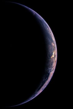 A crescent Earth is seen by the Wide Angle Camera on the Rosetta spacecraft.