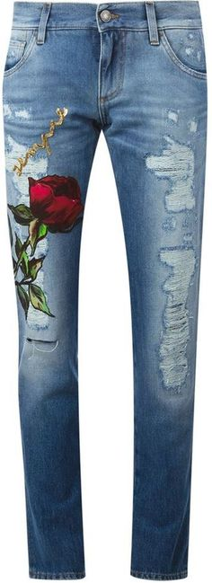 Blue cotton blend rose patch boyfriend jeans from Dolce & Gabbana featuring a low rise, a waistband with belt loops, a button and zip fly, a five pocket design, distressed effects, sequin embroidery and a regular length.