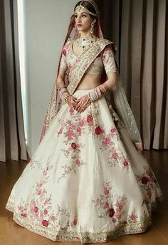 Looking for Bridal Lehenga for your wedding ? Dulhaniyaa curated the list of Best Bridal Wear Store with variety of Bridal Lehenga with their prices Indian Bridal Outfits, Indian Bridal Wear, Indian Designer Outfits, Indian Dresses, Pakistani Bridal, Floral Lehenga, Bridal Lehenga Choli, Lehenga White, Wedding Lehnga