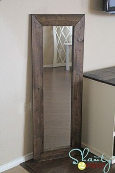 Tutorial for taking a cheap walmart mirror and giving it a wide wood frame - cost 15$.