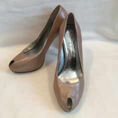 Jessica Simpson, size 7.5, taupe metallic heels Jessica Simpson, size 7.5, taupe metallic platform heels with peep toe with silver inner sole.  Leather upper. Inner platform is approx. 3/4 inches tall.  Heel height is approx. 5 inches. These heels have wear on upper part of heel as there is slight peeling occurring (see 3rd picture). Some internal wear as well. Price reflects wear. See other post for additional pictures. Box not included. Jessica Simpson Shoes Heels