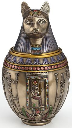 Beautiful Cat Memorial Urn Product Features Perfect gift for those that love Egyptian Made from high quality cold cast resin with bronze finish. Approximately square inches of storage space. Dimensions: H: x W: x L: Beautiful Cat Memorial Urn Memorial Urns, Cat Memorial, Bastet Goddess, Burial Urns, Canopic Jars, Ancient Egyptian Art, Egyptian Mau, Egyptian Jewelry, Ancient Jewelry
