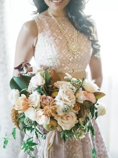 Bridal bouquet With Roses, Magnolia Leaves and Scabiosa Pods. South Asian Bride, South Asian Wedding, Destination Wedding Planner, Wedding Coordinator, Wedding Attire, Wedding Day, Wedding Dresses, Wedding Bouquets, Pink Smoke Bomb