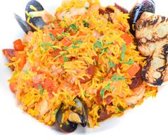saffron rice, mussels, shrimp, chorizo sausage, chicken, tomato-vegetable broth