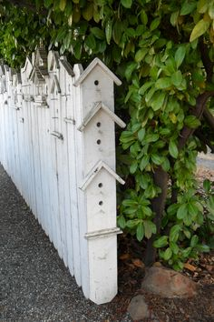 "ADORABLE! Add a simple side piece of wood to an ordinary wooden fence to create a birdhouse fence, by drilling holes or painting in ""holes"" and adding simple roof lines with wood. Cut a picture frame in half and use the corner as the roof. Coat with waterproof sealer before painting. Lots of places to hide a geocache."