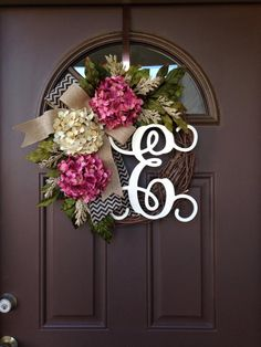 Picture#4 shows script alphabet (12) Picture #5 shows curly alphabet ( 8)  A beautiful ,year-round wreath decorated with 1 cream and 2 rose hydrangea blossoms,hydrangea and peony leaves and cream flock spray,complemented by overlapping burlap bows : chevron black with natural underneath , topped with plain burlap. Made on 18  grapevine wreath base,finished wreath measures approximately 20 -21in diameter and is about 6  deep   This lovely wreath will make a wonderful addition to your home…