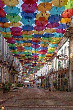 Visit Águeda and discover the amazing Umbrella Sky Project.  #portugal #agueda #streetart #umbrellas