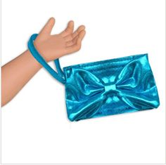 PERFECT GOODY BAG STUFFERS FOR A GIRL'S PARTY!!!  Shimmering turquoise clutch with bow accent, complete with hook-and-loop closure and wrist strap.  Original price: $3.99  SPECIAL PRICE: $.79