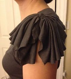 "Take long sleeves off a tee, and fashion them into short, cute ""bow"" sleeves."