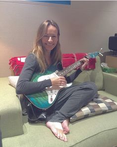 Sharon with Jim's guitar