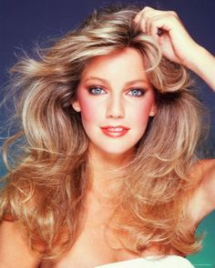 Love this natural blonde color from the 80's. Also, the styling then was softer and more natural, not like the manufactured waves and curls nowadays.
