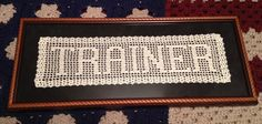Framed filet crochet name.