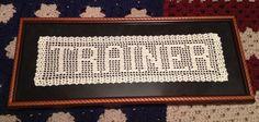 Framed filet crochet name.