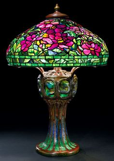 howdoyoulikethemeggrolls:  Lamps from the Tiffany Studios. The bat/star lamp is one of the rarest Tiffany models.