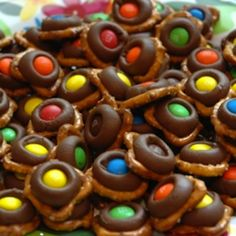 Chocolate Pretzel Bites: Recipe  substitute kiss/hug with rolo or Reese's cup, substitute M&Ms with Reese's pieces.