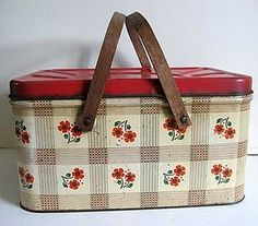 a picnic basket - 0h, I remember these tin baskets!! so cute.  I remember going to have a picnic by the river with Mom and Dad when we were little.  Took the fishing poles and everything!