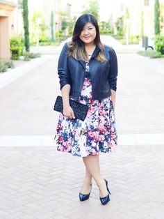 plus size outfit with floral dress and leather moto jacket