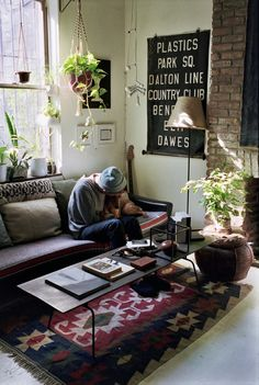 rustic, bohemian living room with plants and awesome prints